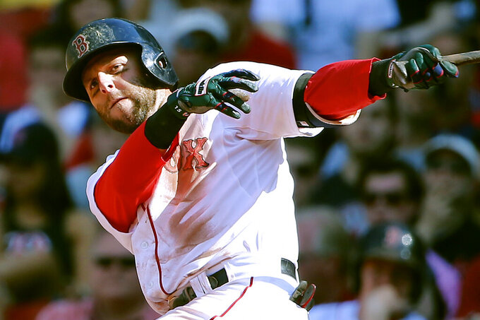 FILE - In this June 13, 2015, file photo, Boston Red Sox's Dustin Pedroia watches a hit against the Toronto Blue Jays during the 10th inning of a baseball game at Fenway Park in Boston. Pedroia, who was the 2007 Rookie of the Year and the AL MVP in his second season, retired Monday, Feb. 1, 2021. (AP Photo/Winslow Townson, File)