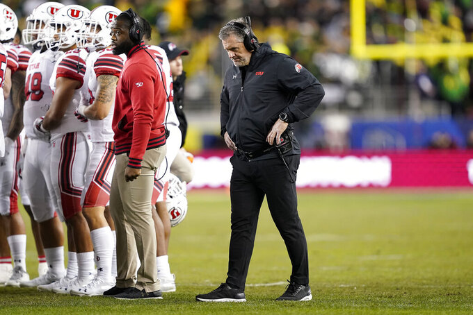 Utah coach Kyle Whittingham walks the sideline during a timeout in the first half of the team's Pac-12 Conference championship NCAA college football game against Oregon in Santa Clara, Calif., Friday, Dec. 6, 2018. (AP Photo/Tony Avelar)