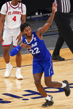 Seton Hall guard Myles Cale gestures after scoring a 3-point basket during the second half of an NCAA college basketball game against St. John's in the quarterfinals of the Big East conference tournament, Thursday, March 11, 2021, in New York. (AP Photo/Mary Altaffer)