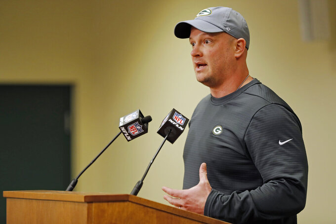 FILE - In this Feb. 18, 2018 file photo, Green Bay Packers' offensive coordinator Nathaniel Hackett addresses the media during a news conference in Green Bay, Wis.   Hackett downplays the notion that he has a revenge motive in Sunday, Nov. 15, 2020 game with the Jacksonville Jaguars, who fired him from the same position two years ago. Hackett was part of Jacksonville coach Doug Marrone's staff in 2017 when the Jaguars advanced to the AFC championship game, but he was dismissed the next year.(AP Photo/Matt Ludtke, File)