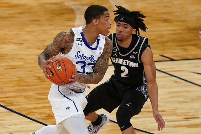 Georgetown's Dante Harris (2) defends against Seton Hall's Shavar Reynolds (33) during the first half of an NCAA college basketball game in the semifinals in the Big East men's tournament Friday, March 12, 2021, in New York. (AP Photo/Frank Franklin II)