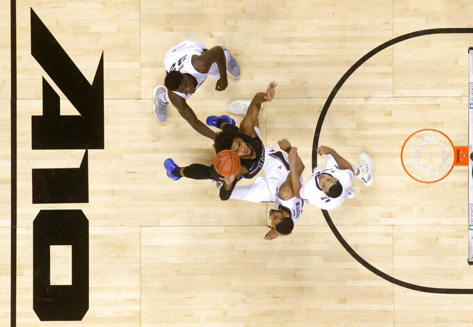 Saint Louis forward Hasahn French, second from left, goes up for a rebound against St. Bonaventure's Amadi Ikpeze, LaDarien Griffin and Dominick Welch, from left, during the first half of an NCAA college basketball game in the final of the Atlantic 10 men's tournament Sunday, March 17, 2019, in New York. Saint Louis won 55-53. (AP Photo/Julio Cortez)