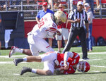 Boston College linebacker John Lamot (28) knocks Rutgers quarterback Art Sitkowski (8) down during the fourth quarter of an NCAA college football game on Saturday, Sept. 21, 2019, in Piscataway, N.J. Boton College won, 30-16. (Andrew Mills//NJ Advance Media via AP)