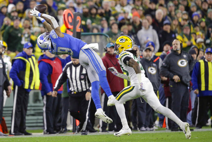 Detroit Lions wide receiver Kenny Golladay (19) makes a leaping catch while covered by Green Bay Packers cornerback Kevin King, right, during the second half of an NFL football game Monday, Oct. 14, 2019, in Green Bay, Wis. (AP Photo/Jeffrey Phelps)
