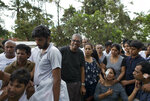 Relatives morn during the burial of three victims of the same family who died at Easter Sunday bomb blast at St. Sebastian Church in Negombo, Sri Lanka, Monday, April 22, 2019. Easter Sunday bombings of churches, luxury hotels and other sites was Sri Lanka's deadliest violence since a devastating civil war in the South Asian island nation ended a decade ago. (AP Photo/Gemunu Amarasinghe)