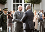 Belgian Prime Minister Charles Michel, center left, greets Democratic Republic of Congo President Felix Tshisekedi during an arrival ceremony at the Egmont Palace in Brussels, Tuesday, Sept. 17, 2019. (AP Photo/Virginia Mayo)