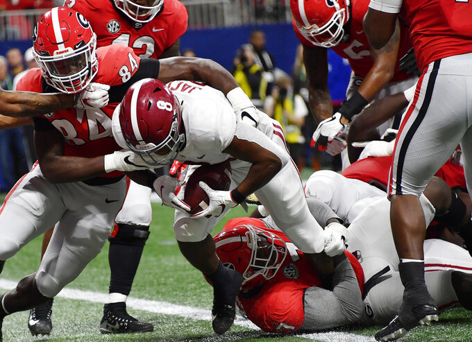 Alabama running back Josh Jacobs (8) runs into the end zone against Georgia linebacker Walter Grant (84) during the first half of the Southeastern Conference championship NCAA college football game, Saturday, Dec. 1, 2018, in Atlanta. (AP Photo/John Amis)