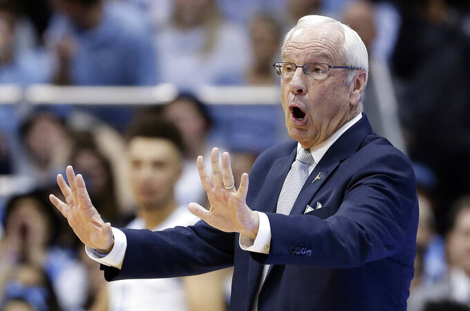 North Carolina head coach Roy Williams reacts during the second half of an NCAA college basketball game against Virginia in Chapel Hill, N.C., Monday, Feb. 11, 2019. (AP Photo/Gerry Broome)
