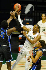 Miami forward Anthony Walker (1) attempts to pass the ball as Duke center Mark Williams (15) defends during the second half of an NCAA college basketball game, Monday, Feb. 1, 2021, in Coral Gables, Fla. (AP Photo/Marta Lavandier)