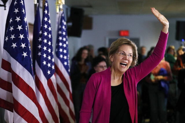Democratic presidential candidate Sen. Elizabeth Warren, D-Mass., arrives at a town hall meeting, Monday, Dec. 16, 2019, in Keokuk, Iowa. (AP Photo/Charlie Neibergall)