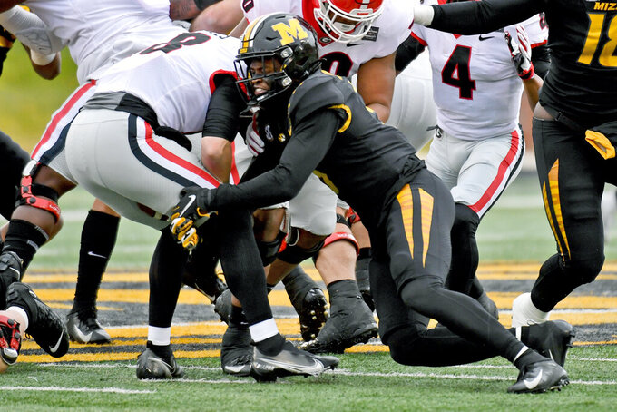 Missouri safety Martez Manuel, right, sacks Georgia quarterback JT Daniels during the first half of an NCAA college football game Saturday, Dec. 12, 2020, in Columbia, Mo. (AP Photo/L.G. Patterson)