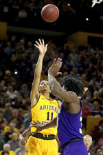 Arizona State's Alonzo Verge (11) shoots over Washington's Isaiah Stewart (33) during the second half of an NCAA college basketball game Thursday, March 5, 2020, in Tempe, Ariz. (AP Photo/Darryl Webb)