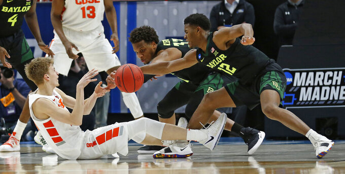 Syracuse forward Marek Dolezaj, left, battles with Baylor's Freddie Gillespie (33) and Jared Butler (12) for a loose ball during the second half of a first-round game in the NCAA men's college basketball tournament Thursday, March 21, 2019, in Salt Lake City. (AP Photo/Rick Bowmer)