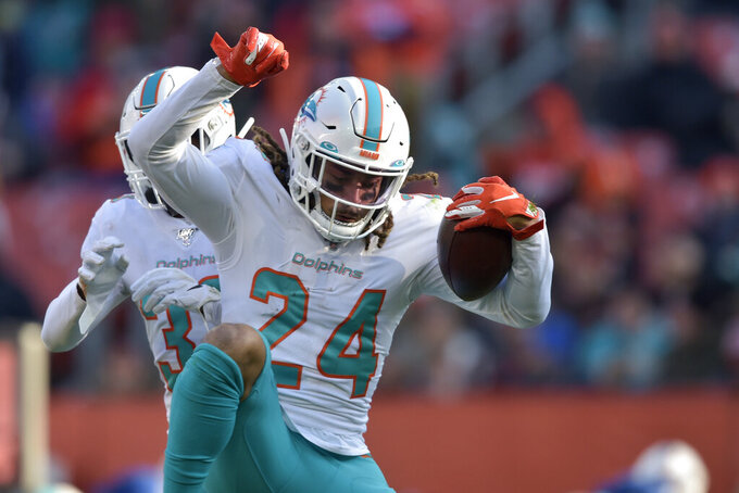 Miami Dolphins cornerback Ryan Lewis celebrates an interception during the second half of an NFL football game against the Cleveland Browns, Sunday, Nov. 24, 2019, in Cleveland. (AP Photo/David Richard)