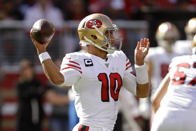 San Francisco 49ers quarterback Jimmy Garoppolo throws the ball during the first half of an NFL football game against the Carolina Panthers in Santa Clara, Calif., Sunday, Oct. 27, 2019. (AP Photo/Ben Margot)