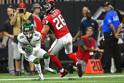 New York Jets wide receiver Robby Anderson (11) makes a catch ahead of Atlanta Falcons free safety Isaiah Oliver (26) during the first half an NFL preseason football game, Thursday, Aug. 15, 2019, in Atlanta. (AP Photo/John Amis)
