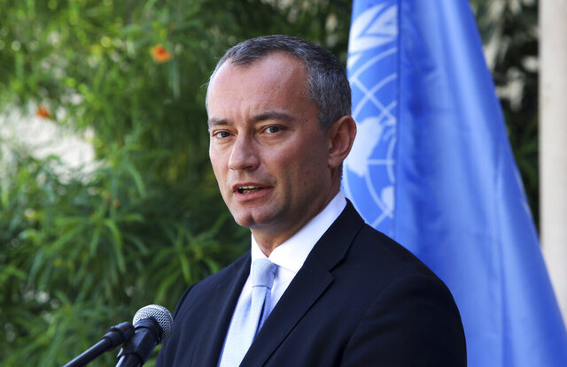"FILE - In this Sept. 25, 2017 file photo, the U.N. special envoy for the Middle East Peace Process Nickolay Mladenov, attends a press conference at the (UNSCO) offices in Gaza City. Mladenov has turned down an offer to lead the U.N. mission in conflict-stricken Libya, according to a U.N. spokesman. Mladenov told U.N. Secretary-General Antonio Guterres on Monday, Dec. 21, 2020, that he would not take up the position of special envoy for the North African country ""for personal and family reasons,"" said U.N. spokesman Stephane Dujarric on Tuesday. (AP Photo/Adel Hana, File)"
