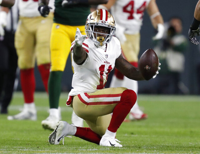 FILE - In this Oct. 15, 2018, file photo, San Francisco 49ers wide receiver Marquise Goodwin (11) celebrates after a catch for a first down during the second half of an NFL football game against the Green Bay Packers in Green Bay, Wis. The Philadelphia Eagles have acquired wide Goodwin from the San Francisco 49ers. The teams flipped sixth-round picks with Philadelphia getting No. 210 and San Francisco receiving No. 190 on Saturday, April 25, 2020.(AP Photo/Matt Ludtke, File)