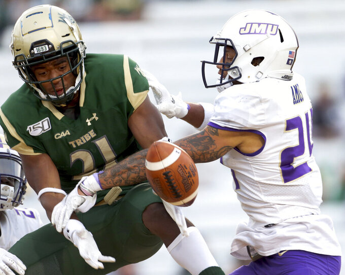 James Madison's D'Angelo Amos, right, knocks down a pass intended for William & Mary's Jordan Lowery during the second half of an NCAA college football game in Williamsburg, Va., on Saturday, Oct. 19, 2019.  (Daniel Sangjib Min/Richmond Times-Dispatch via AP)