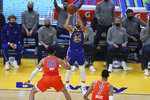 Golden State Warriors' Stephen Curry, center, shoots a 3-pointer against Oklahoma City Thunder's Isaiah Roby during the first half of an NBA basketball game in San Francisco, Saturday, May 8, 2021. (AP Photo/Jed Jacobsohn)