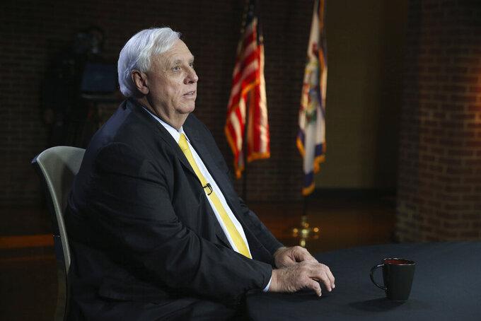 West Virginia Gov. Jim Justice prepares for a debate with Democratic challenger, Kanawha County Commissioner Ben Salango in Morgantown, W.Va., Tuesday Oct. 13. 2020. (AP Photo/Kathy Batten)