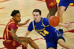 South Dakota State guard Alex Arians loses the ball in front of Iowa State guard Tyler Harris, left, during the first half of an NCAA college basketball game, Wednesday, Dec. 2, 2020, in Ames, Iowa. (AP Photo/Charlie Neibergall)