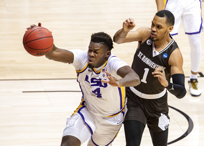 LSU forward Darius Days (4) chases after a loose ball with St. Bonaventure guard Dominick Welch (1) during the first half of a first round game in the NCAA men's college basketball tournament, Saturday, March 20, 2021, at Assembly Hall in Bloomington, Ind. (AP Photo/Doug McSchooler)