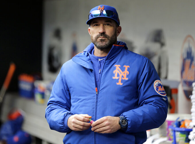 FILE - In this Sunday, April 28, 2019, file photo, then-New York Mets manager Mickey Callaway stands by the dugout before a baseball game against the Milwaukee Brewers at Citi Field, in New York. Former New York Mets manager Mickey Callaway was suspended by Major League Baseball on Wednesday, May 26, 2021 through at least the end of the 2022 season following an investigation of sexual harassment allegations. (AP Photo/Seth Wenig, File)
