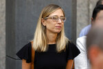 Annie Framer, one of Jeffrey Epstein's accusers who spoke at his bail hearing, attends a news conference outside federal court, in New York, Monday, July 15, 2019. Farmer says she was 16 when she
