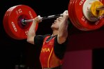 Shi Zhiyong of China competes in the men's 73kg weightlifting event, at the 2020 Summer Olympics, Wednesday, July 28, 2021, in Tokyo, Japan. (AP Photo/Luca Bruno)