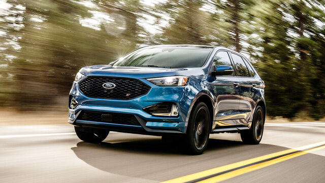 This undated photo provided by Ford shows the Ford Edge ST, a midsize SUV. Armed with a turbocharged V6 making 335 horsepower, it is quicker to accelerate than most other rival SUVs. It also comes with a sport-tuned suspension, more powerful brakes and unique styling changes. (Ford Motor Co. via AP)