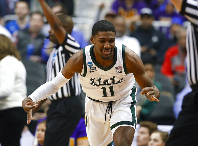 Michigan State forward Aaron Henry gestures after making a 3-pointer against LSU during the first half of an East Regional semifinal in the NCAA men's college basketball tournament in Washington, Friday, March 29, 2019. (AP Photo/Patrick Semansky)
