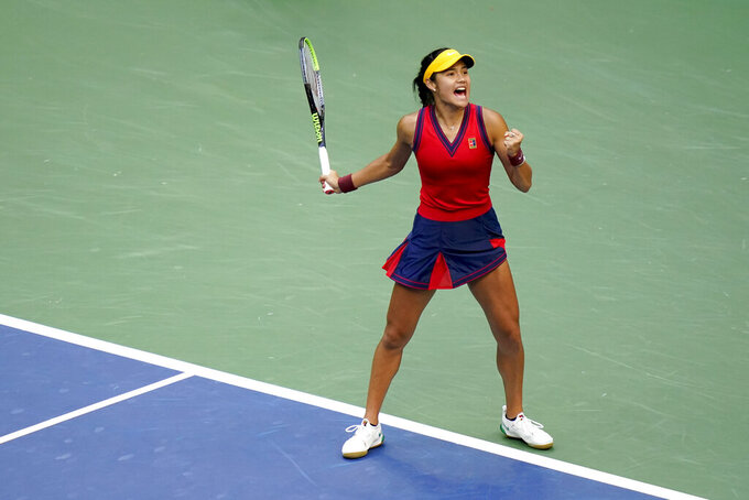 Emma Raducanu, of Britain, reacts after scoring a point against Leylah Fernandez, of Canada, during the women's singles final of the US Open tennis championships, Saturday, Sept. 11, 2021, in New York. (AP Photo/Frank Franklin II)