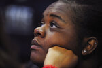 Alana Hall, a Penn State student from Philadelphia. watches a video tribute to Kobe Bryant before Penn State's NCAA college basketball game against Indiana, Wednesday, Jan. 29, 2020, in State College, Pa. (AP Photo/Gary M. Baranec)
