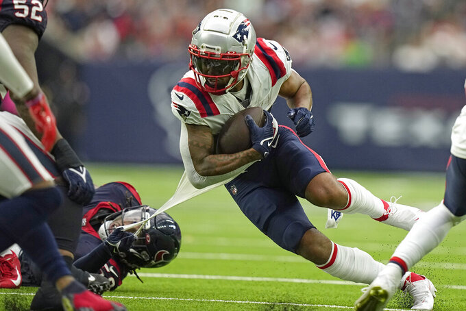 Houston Texans' Christian Kirksey, left, grabs the shirt of New England Patriots wide receiver Kendrick Bourne while trying to tackle him during the second half of an NFL football game Sunday, Oct. 10, 2021, in Houston. (AP Photo/Eric Christian Smith)
