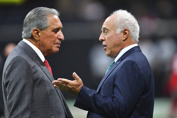 Atlanta Falcons owner Arthur Blank, left, speaks with Philadelphia Eagles owner Jeffrey Lurie before the first half of an NFL football game, Sunday, Sept. 15, 2019, in Atlanta. (AP Photo/John Amis)