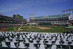 Cutouts are seated at Oakland Coliseum as San Francisco Giants' Kevin Gausman pitches to Oakland Athletics' Matt Olson during the fourth inning of a baseball game in Oakland, Calif., Saturday, Sept. 19, 2020. (AP Photo/Jeff Chiu)