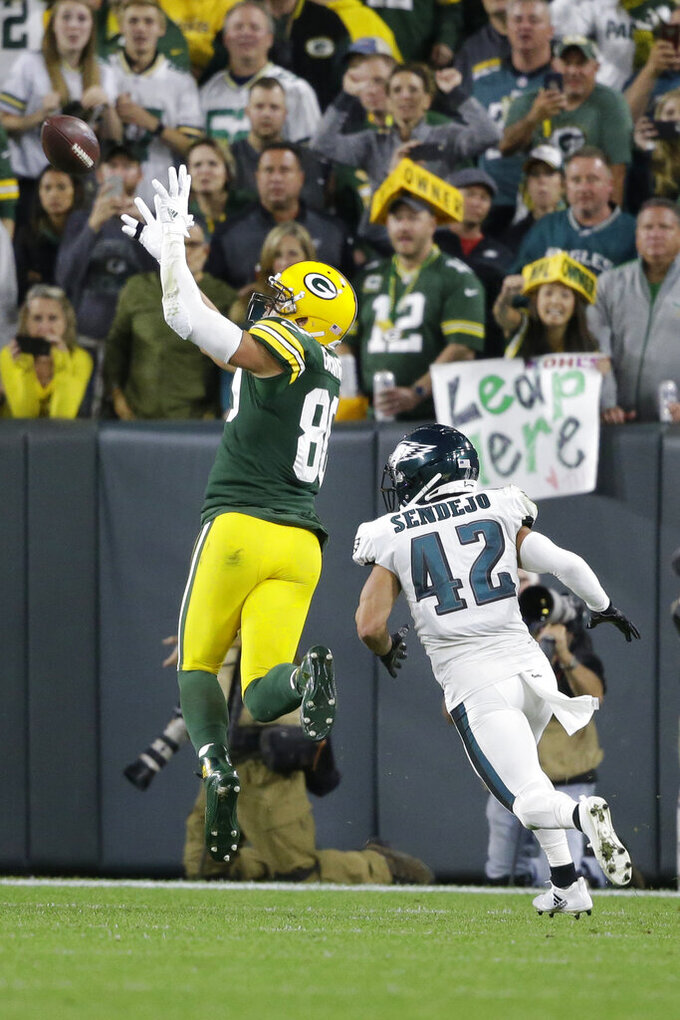 Green Bay Packers tight end Jimmy Graham pulls down a catch for a touchdown while being covered by Philadelphia Eagles strong safety Andrew Sendejo (42) during the second half of an NFL football game Thursday, Sept. 26, 2019, in Green Bay, Wis. (AP Photo/Jeffrey Phelps)