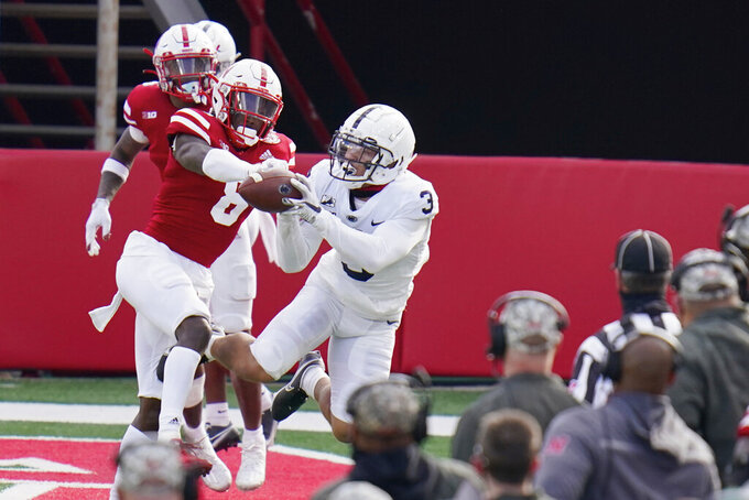 Penn State wide receiver Parker Washington (3) makes a catch against Nebraska safety Deontai Williams (8) during the second half of an NCAA college football game in Lincoln, Neb., Saturday, Nov. 14, 2020. Nebraska won 30-23. (AP Photo/Nati Harnik)