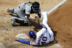 Chicago Cubs' Willson Contreras, bottom, scores on a one-run double by Kyle Schwarber as Pittsburgh Pirates catcher Jacob Stallings misses the catch during the fifth inning of a baseball game in Chicago, Sunday, Aug. 2, 2020. (AP Photo/Nam Y. Huh)