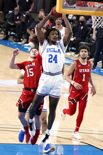 UCLA forward Jalen Hill (24) drives past Utah guard Rylan Jones (15) during the second half of an NCAA college basketball game Thursday, Dec. 31, 2020, in Los Angeles. (AP Photo/Marcio Jose Sanchez)