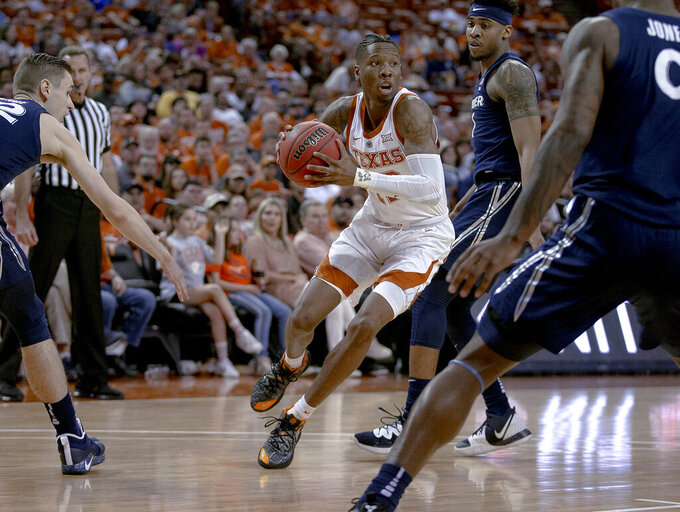 Texas guard Kerwin Roach II (12) drives against Xavier guard Paul Scruggs (1) during an NCAA college basketball game in the second round of the NIT on Sunday, March 24, 2019, in Austin, Texas. (Nick Wagner/Austin American-Statesman via AP)