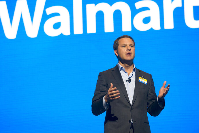 FILE - In this June 2, 2017 file photo, Walmart CEO Doug McMillon speaks during the Walmart shareholders meeting at Bud Walton Arena in Fayetteville, Ark. The Business Roundtable, a group that represents the most powerful companies in America, is naming McMillon as its new chairman. McMillon succeeds JPMorgan Chase Chairman and CEO Jamie Dimon in the role. Dimon will continue to serve as a board member after completing his tenure as the group's chairman at year's end.  (Jason Ivester/The Northwest Arkansas Democrat-Gazette via AP, File)