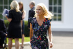 FILE - In this Sept. 27, 2019, file photo, Counselor to the President Kellyanne Conway walks to speaks to media at White House in Washington. As the impeachment inquiry gains steam, top White House officials are pulling off a well-timed disappearing act. They've skipped high-profile TV shows and avoided driveway chat sessions with reporters.  (AP Photo/Carolyn Kaster, File)