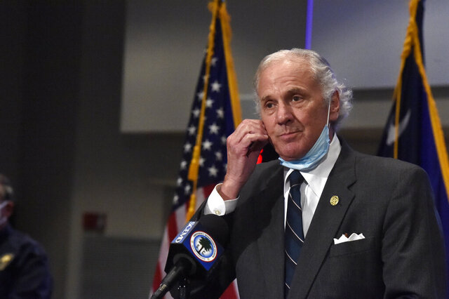 South Carolina Gov. Henry McMaster removes his mask while speaking during a COVID-19 briefing on Wednesday, July 29, 2020, in West Columbia, S.C. As of Monday, McMaster says all businesses will be allowed to be open, as long as they adhere to social distancing and capacity limits. (AP Photo/Meg Kinnard)