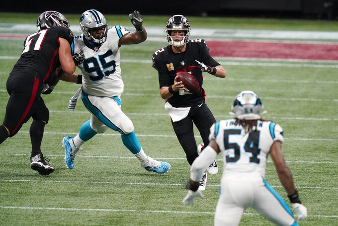 Atlanta Falcons quarterback Matt Ryan (2) works under pressure against the Carolina Panthers during the first half of an NFL football game, Sunday, Oct. 11, 2020, in Atlanta. (AP Photo/Brynn Anderson)