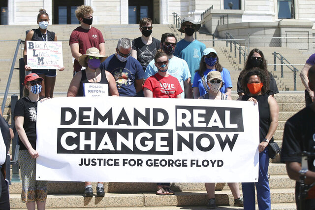Protesters demanding change in the wake of the death of George Floyd hold a media briefing outside the Minnesota State Capitol, Friday, June 12, 2020, in St. Paul, Minn., where a special session of the legislature was about to begin. (AP Photo/Jim Mone)
