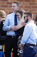 Pallbearers console each other after guiding the casket to a waiting hearse at the conclusion of a memorial service for Kendrick Castillo, who was killed in the assault on the STEM Highlands Ranch School, Wednesday, May 15, 2019, in Highlands Ranch, Colo. (AP Photo/David Zalubowski)