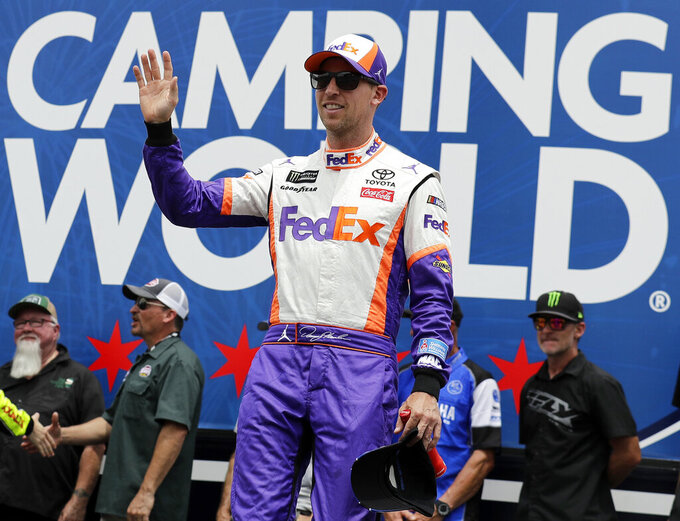 Denny Hamlin waves to the crowd during driver introductions before a NASCAR Cup Series auto race at Chicagoland Speedway in Joliet, Ill., Sunday, June 30, 2019. (AP Photo/Nam Y. Huh)