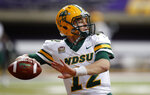 FILE - In this Saturday, Oct. 6, 2018, file photo, North Dakota State quarterback Easton Stick warms up before an NCAA college football game against Northern Iowa, in Cedar Falls, Iowa. North Dakota State begins its hunt for its seventh Football Championship Subdivision title in eight years with a familiar ingredient on offense: a high-quality quarterback with plenty of experience in senior Stick. (AP Photo/Charlie Neibergall, File)